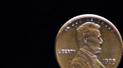 Stock Video Footage of Coins of America one cent close up turns on black background . Right side