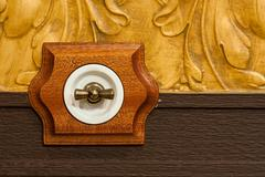 Antique wooden light switch - stock photo