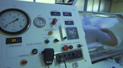 Panel with buttons of hyperbaric chambers with a man in a capsule of oxygen Stock Footage