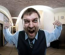 Man screaming at office - stock photo