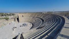 Tourists at the Famous Historical Roman amphitheater at Caesarea Stock Footage