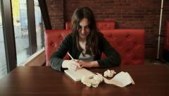 Girl in a creative process drawing crumples  pape Stock Footage
