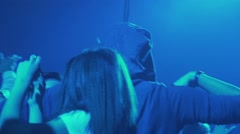 women dancing in a disco lit by blue light in slow motion - stock footage