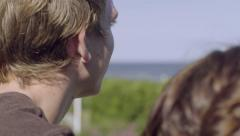 Teenage Boy Talks And Flirts With Girl On A Bridge, They Enjoy View Of Ocean Stock Footage