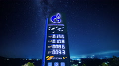 4K Timelapse. Road billboard Gazpromneft with gasoline prices in night Stock Footage
