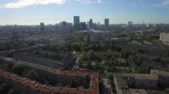 Stock Video Footage of Aerials Rotterdam Slow descend with city center backdrop and green roof