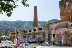 Abandoned factory building with graffiti art. Kotor it is a very popular trav Stock Photos