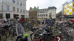 Bikes park in street parking lot in central location Stock Footage