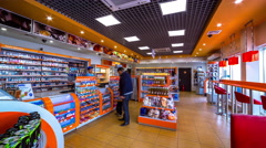 4K Timelapse. People buy in the store the gas station Gazpromneft. Camera 2 Stock Footage