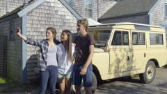 Group Of Teens Take A Selfie Together In Front Of Vintage Yellow Car Stock Footage