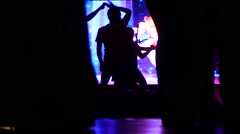 Salsa dance legs silhouettes spinning stombing on spot lights lumiere dancefloor Arkistovideo