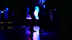Salsa dance silhouettes spinning in spot lights lumiere dancefloor - stock footage