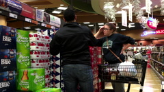 Couple buying Budweiser beer Stock Footage