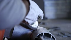 Man with protective gloves using angle grinder on steel Stock Footage