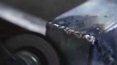 Man using angle grinder on steel Stock Footage