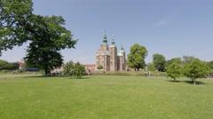 People walk in Kongens Have garden park, near Rosenborg Castle Stock Footage