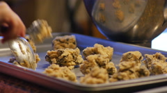 Child Placing Cookie Dough on Pan Making Chocolate Chip Cookies, 4K - stock footage