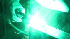 Equipped man and welding steel equipped with a gas welding machine Stock Footage