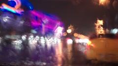 Neon signs and rainy night street bokeh lights. 50 mm f1.8 - stock footage