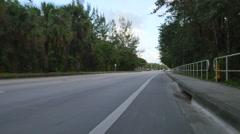 Riding a bike in the bike lane Stock Footage