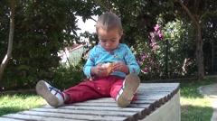 Child fully focused on peelings a mandarin- Stock Footage