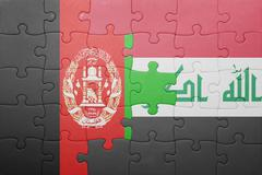 puzzle with the national flag of iraq and afghanistan - stock photo