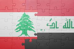 Stock Photo of puzzle with the national flag of iraq and lebanon