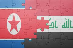 puzzle with the national flag of iraq and north korea - stock photo