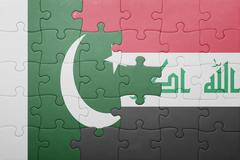 puzzle with the national flag of iraq and pakistan - stock photo
