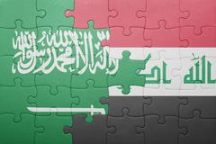 puzzle with the national flag of iraq and saudi arabia - stock photo