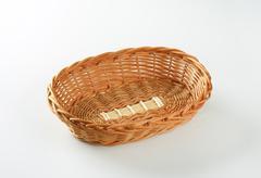 Empty oval wicker bread basket - stock photo