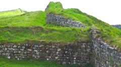 An establishing shot of Hadrians Wall in northern England. - stock footage