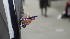 4K Attractive businessman using smartphone for navigation outdoors in the city Stock Footage