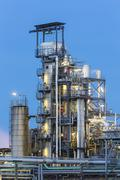 Detail of distillation towers in a chemical plant and refinery with night blu Stock Photos