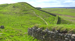 An establishing shot of Hadrians Wall in northern England. Stock Footage