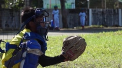Boy athlete training to catch baseball Stock Footage
