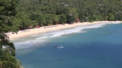 Stock Video Footage of Tropical beach, coconut palm tree and sea water wave. Island Phangan, Thailand