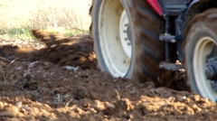 Tractor plowing land with plow Stock Footage