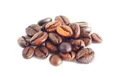 Small heap of coffee beans - stock photo