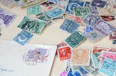 Collection of old postage stamps - stock photo