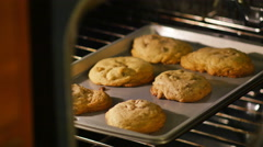 Child Taking Chocolate Chip Cookies Out of Oven, 4K Stock Footage