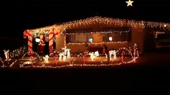 A house decorated with Christmas lights - stock footage