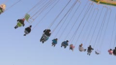 Children on Carrousel at Summer Stockfootage - Download Full HD Stock Footage