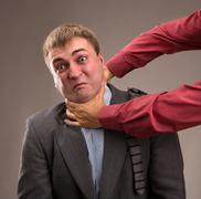 Aggressive office worker put up a fight - stock photo