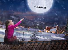 Girl on the roof in winter night - stock photo