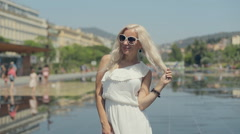 Romantic girl in sunglasses walking on the French Riviera Stock Footage