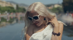 Girl in sunglasses walking on the French Riviera at Place Massena Stock Footage