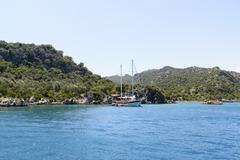 Kemer, Turkey - 06.20.2015. Boat with tourists near  coast of Turkey - stock photo