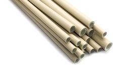 Plastic pipes on white - stock photo