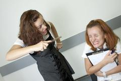 Anger teacher and afraid student - stock photo